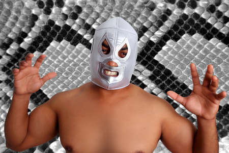 mexican wrestling mask silver fighter gesture snake texture background photo