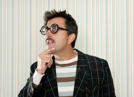 myopic: crazy nerd man myopic thinking gesture expression funny glasses man Stock Photo