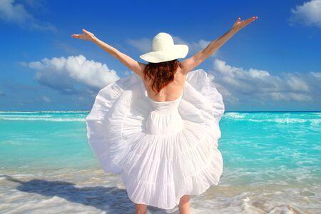 beach rear woman wind shaking white dress tropical turquoise Caribbean photo
