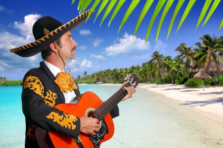 Charro mexican Mariachi playing guitar in tropical Mexico beach photo