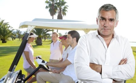 Golf senior golfer man portrait in green course outdoor young people cart background photo