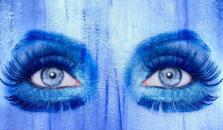 abstract blue eyes makeup woman grunge painted wall texture photo
