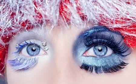 asymmetrical christmas concept eye makeup winter red silver macro closeup photo