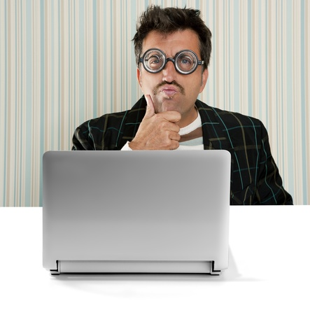 Nerd pensive man glasses silly expression laptop computer thinking a solution Stock Photo - 9705977
