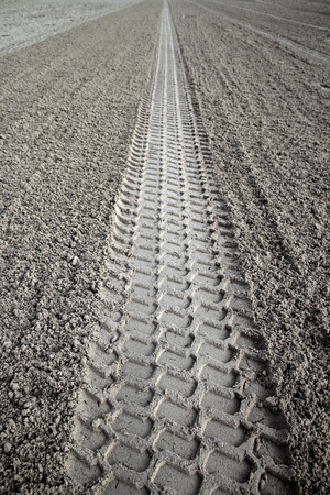 beach sand tyres footprint perspective to infinite Caribbean cleaning tractor Stock Photo - 9706507