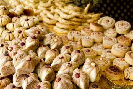 arab sweet pastries cakes stacked bakery with nuts photo