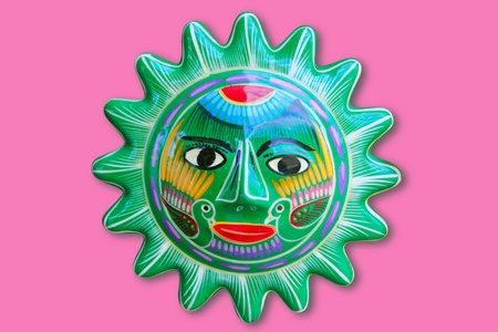 Mexican indian sun handcraft ceramic isolated in pink background photo