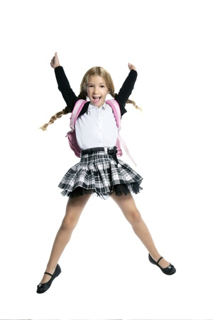 uniform skirt: full length stand up little blond school girl with backpack bag high jump on white background Stock Photo