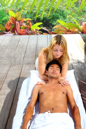 massage therapy stretch head neck outdoor in rainforest jungle Stock Photo - 9941333