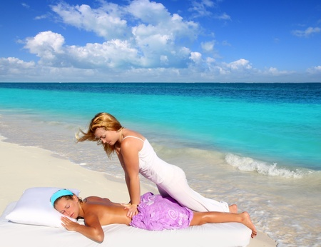 Caribbean beach massage shiatsu waist pressure woman outdoor paradise Stock Photo - 9941322