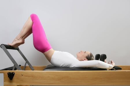 pilates reformer woman gym fitness teacher legs exercise photo