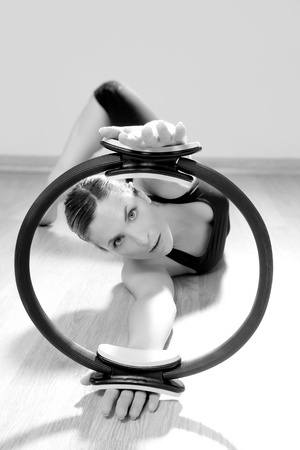 magic pilates ring woman aerobics sport gym exercises on wooden floor Stock Photo - 9941280