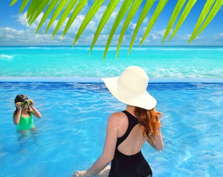 blue swimming pool caribbean view mother and goggles daughter photo