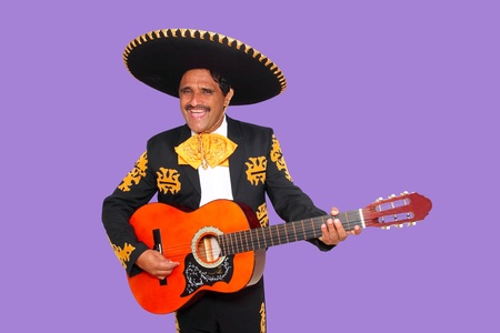 Charro Mariachi singing playing guitar on purple background photo