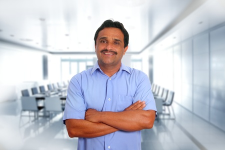 Indian latin businessman blue shirt in boardroom office background photo