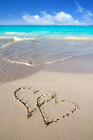 mayan riviera: hearts in love written in Caribbean tropical beach sand