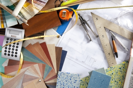 interior designer: Architect or interior designer workplace desk and design tools with lots of construction material samples