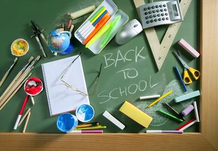 Back to school written in green blackboard education concept still life Stock Photo - 9941657