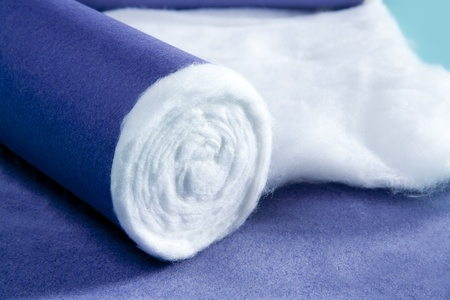 firstaid: blue rolled medical pharmaceutical cotton macro detail Stock Photo