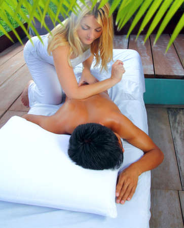 female elbow: Mayan massage paravertebral therapy in jungle cabin latin and asian technics Stock Photo