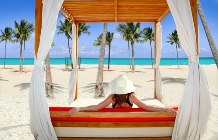 beds: gazebo tropical beach with woman rear view looking sea from a tropical resort Stock Photo