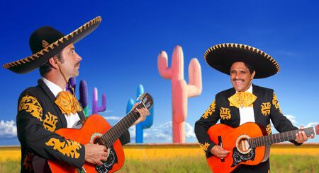 Mexican two mariachis with charro costume singing playing guitar in cactus Mexico photo