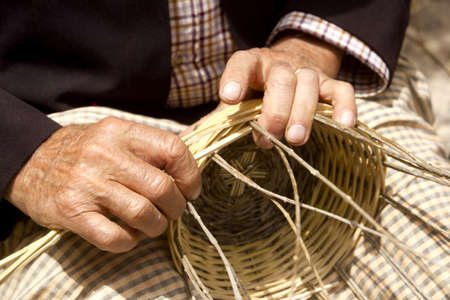 enea: craftsman hands working basketry in Mediterranean  Balearic islands Stock Photo