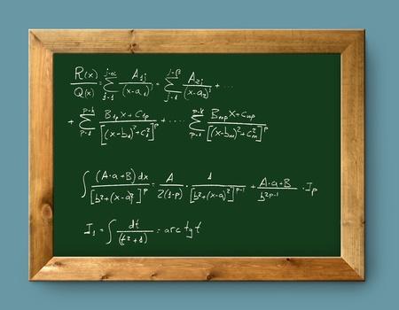 green blackboard with written difficult mathematical integral formula photo