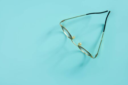 doctor glasses with soft shadow over green desk background photo