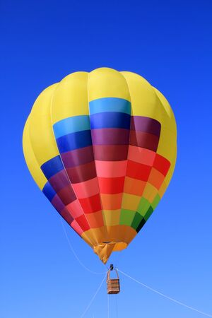 balloon colorful with vivid colors flying in blue sky photo