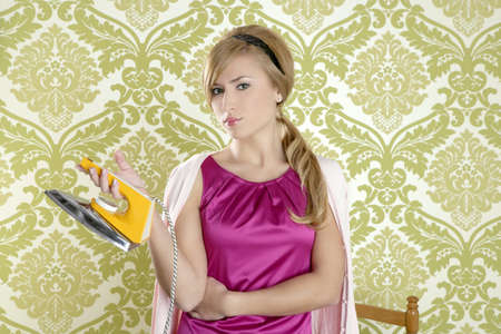 vintage woman with retro clothes iron like an humor housewife over 60s wallpaper Stock Photo - 9941962