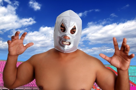 mexican wrestling mask silver fighter with aggresive gesture in stadium photo