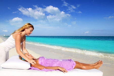 Mayan reiki therapy massage in Caribbean beach with two women Stock Photo - 9941908