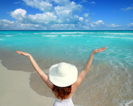 Caribbean beach woman rear view spending happy vacation with open arms gesture Stock Photo - 9941975