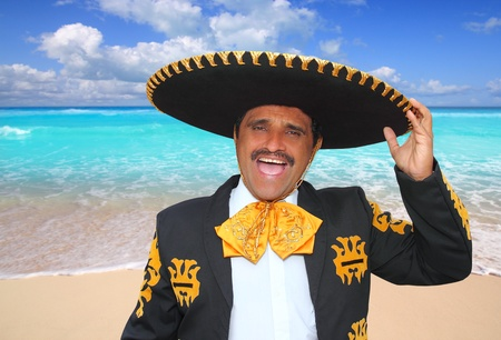 hispanics mexicans: Charro mariachi man portrait shouting in Mexico Caribbean beach