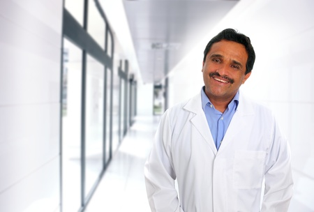 Indian latin expertise doctor smiling in the hospital corridor photo