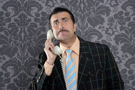 dork: businessman with scared expression talking by  telephone with retro mustache
