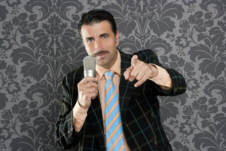 tacky: retro mustache singer man tacky suit on vintage wallpaper background