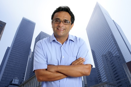asian architect: american indian businessman on a downtown urban city skyscraper buildings Stock Photo