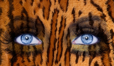 abstract blue woman eyes makeup with a leopard jaguar skin texture photo