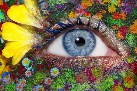 blue woman eye makeup inspired in spring with flowers meadow and yellow petals photo