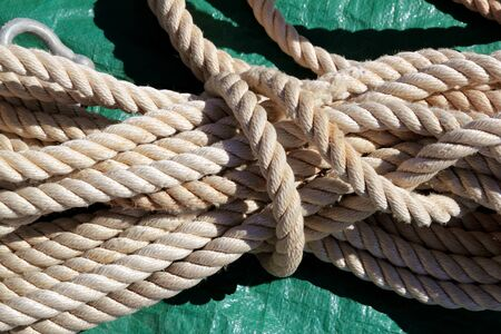marine clear white rope over green background photo