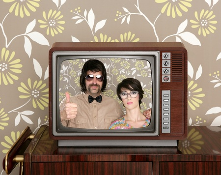 old wooden tv with nerd silly couple retro in screen on wallpaper background photo