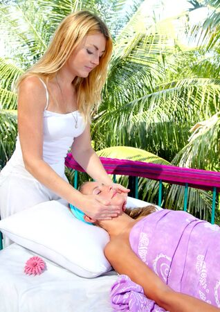 facial massage therapy in caribbean outdoor palm trees jungle photo