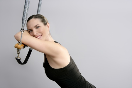 pilatesinstructor woman portrait in Cadillac trapeze Stock Photo - 9942123