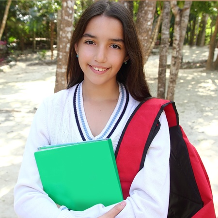 hispanic latin mexican teenager student girl with backpack in the park photo
