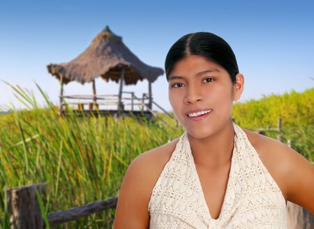 sunroof: Latin hispanic mayan woman portrait in wetlands with hut background