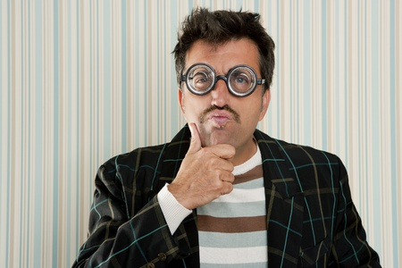 myopic: nerd silly myopic man with glasses thinking doing funny gesture with retro mustache