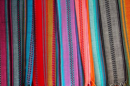 Indian colorful scarf in a row with vivid colors stripes photo