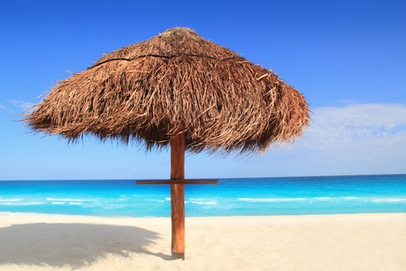 palapa sun roof beach umbrella in caribbean photo